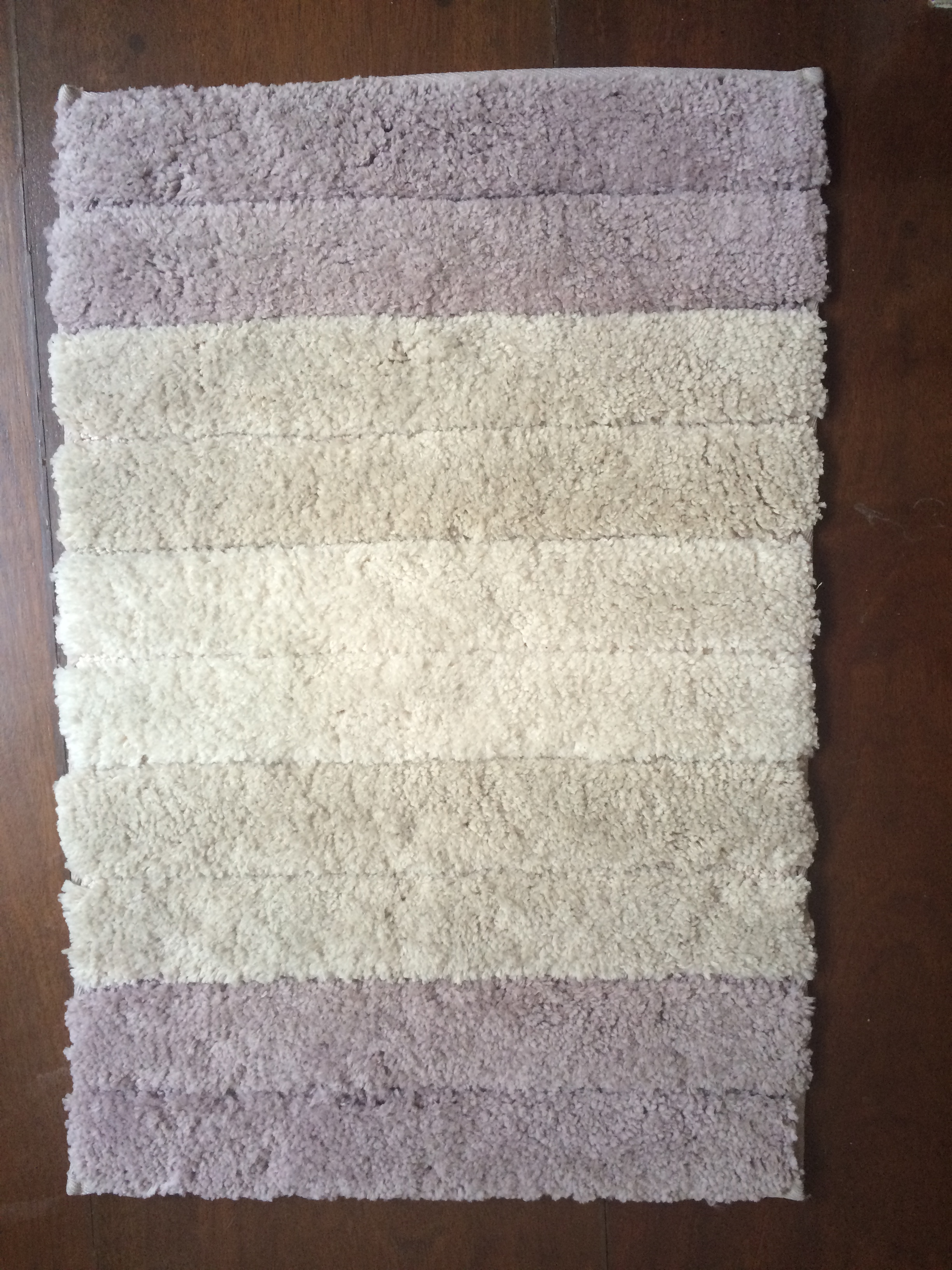 A microfiber bathroom rug is small enough for the narrow space (it's a stair landing, after all).