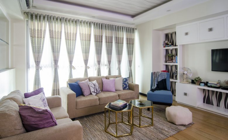 condo living room with blue and purple accents