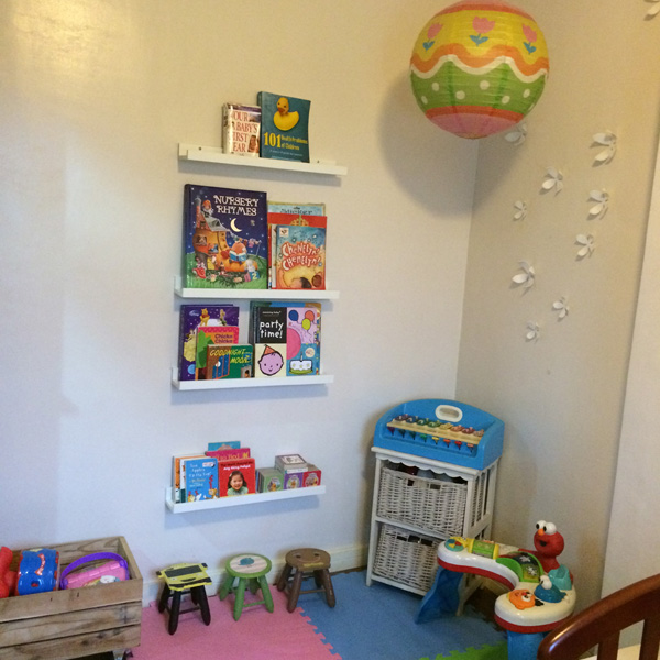 A portion of the nursery. I don't have a proper photo of her current bed yet. Plus this is now filled to the brim with books and toys!