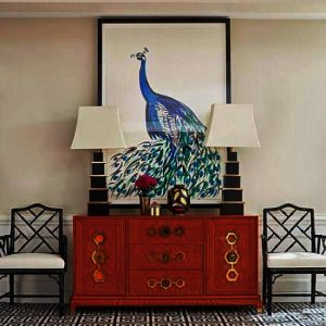 Image of red Oriental cabinet with peacock artwork over it