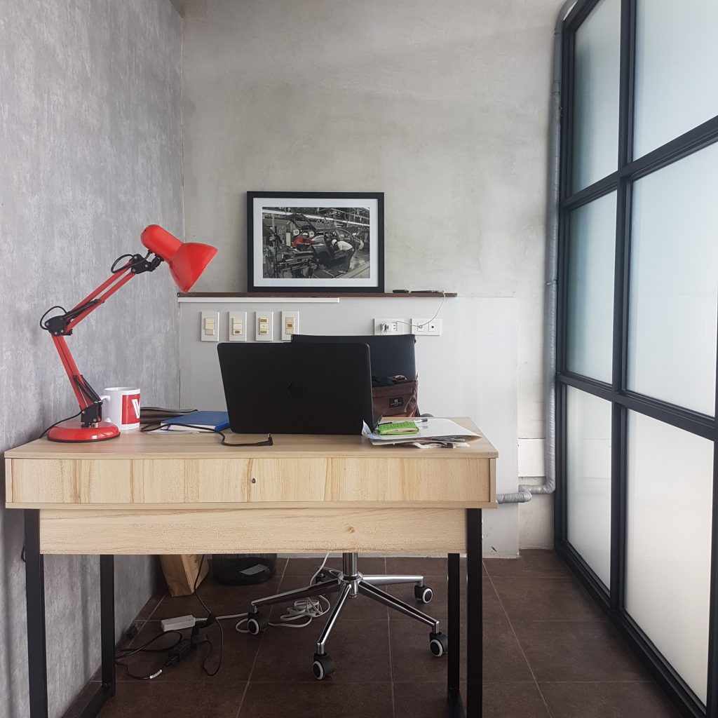 office desk with red lamp