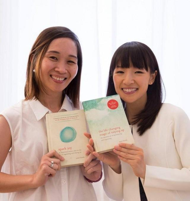 Christine Dychiao with Marie Kondo, holding up Marie's bestselling books