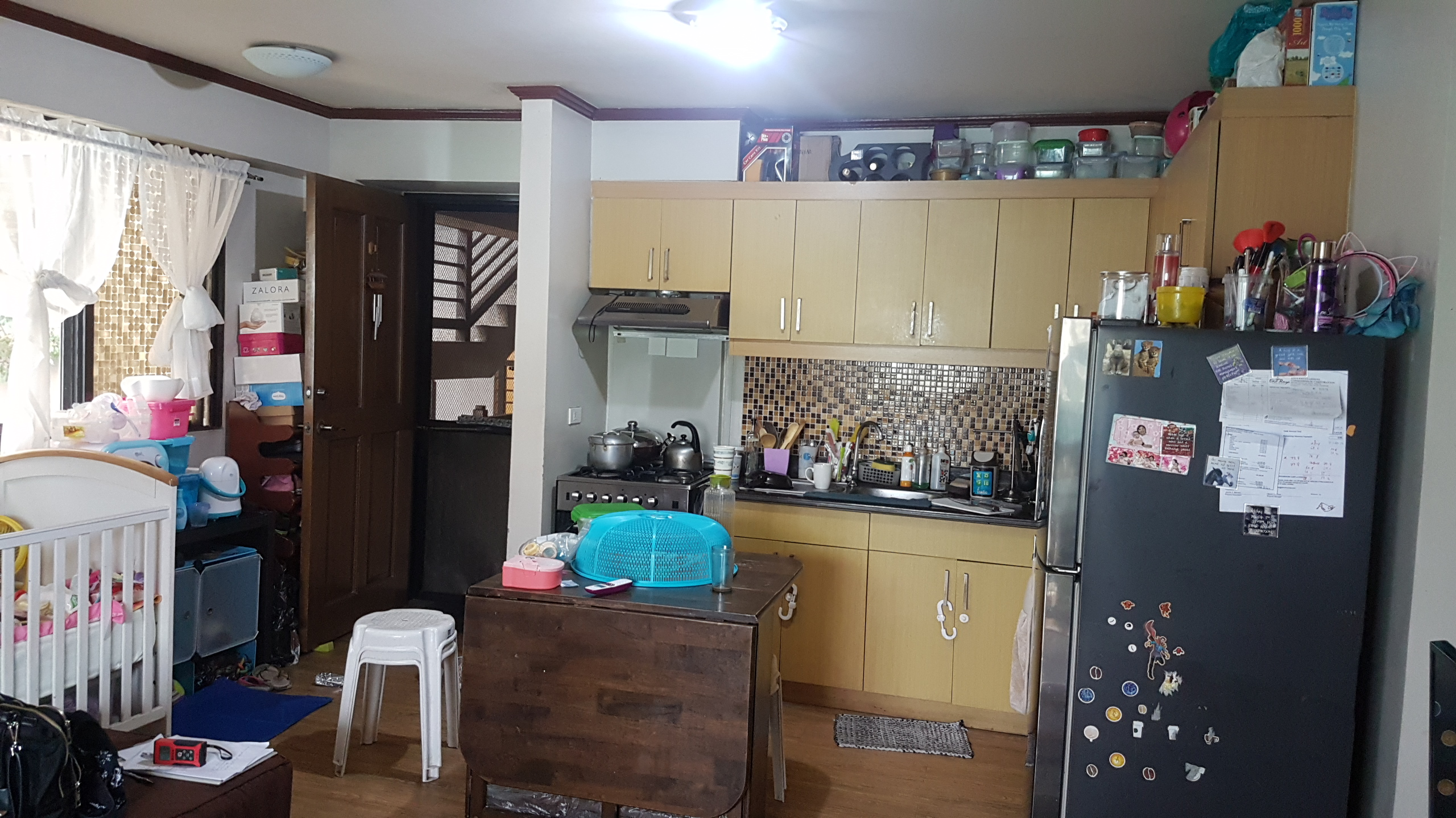 cluttered kitchen before shot full condo renovation organize decorate