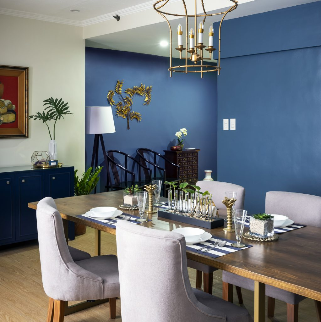 Blue dining room with brass and wood accents