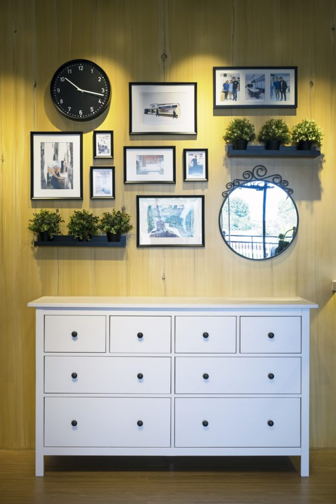 gallery wall with frames mirrors clock and wall decor
