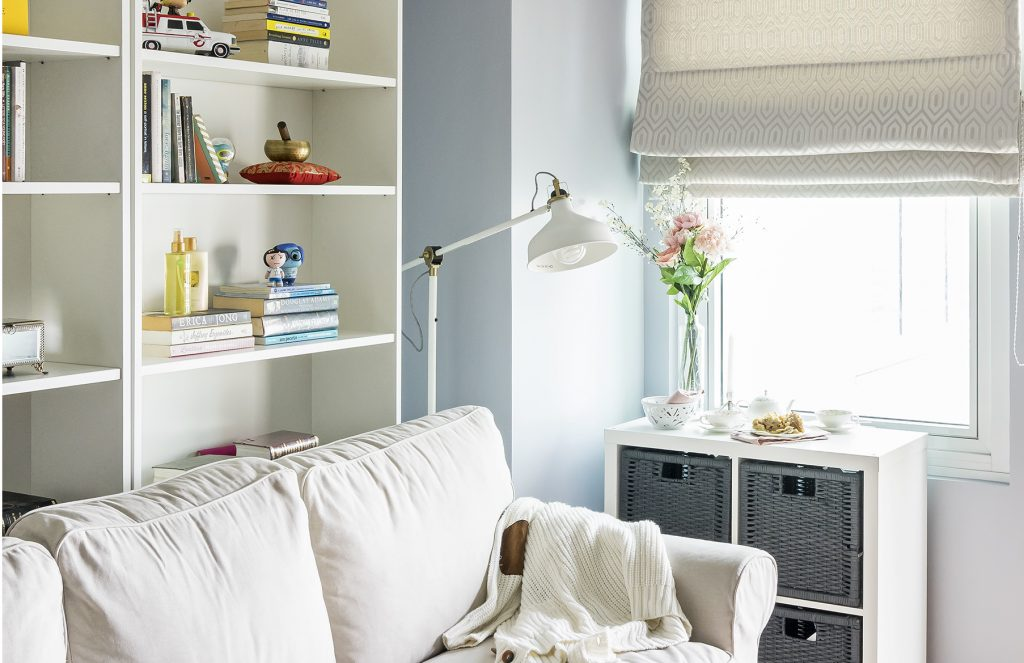 Gal at Home-designed living room setup with white furniture
