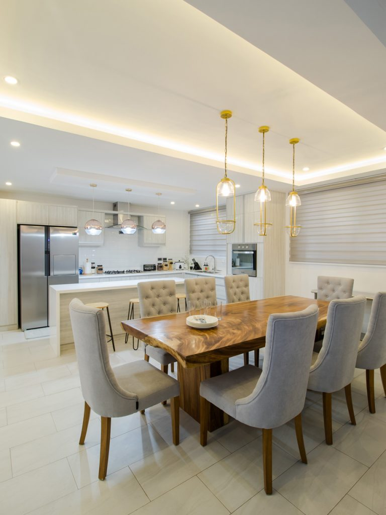 open-plan dining and kitchen with drop lamps