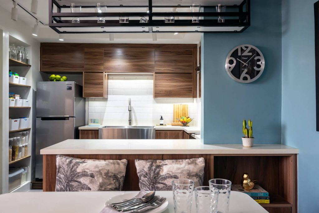 condo kitchen with stainless sink bar counter and dining banquette