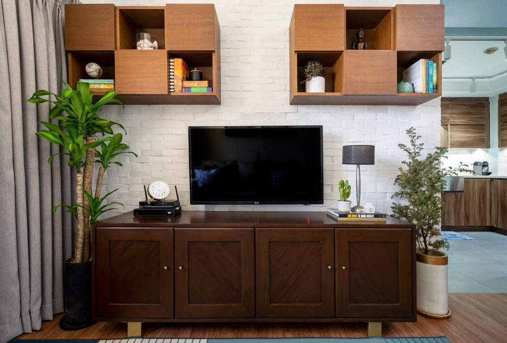 custom wall cabinets and media cabinet in different wood tones