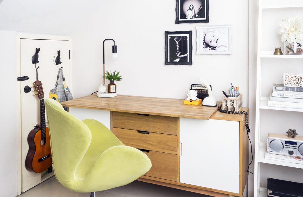 green chair in home office setup