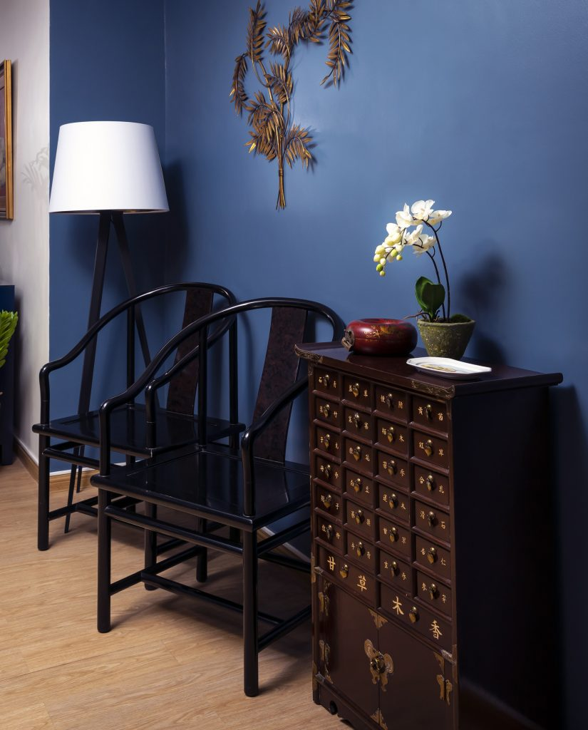 apothecary cabinet and chairs in blue home entryway