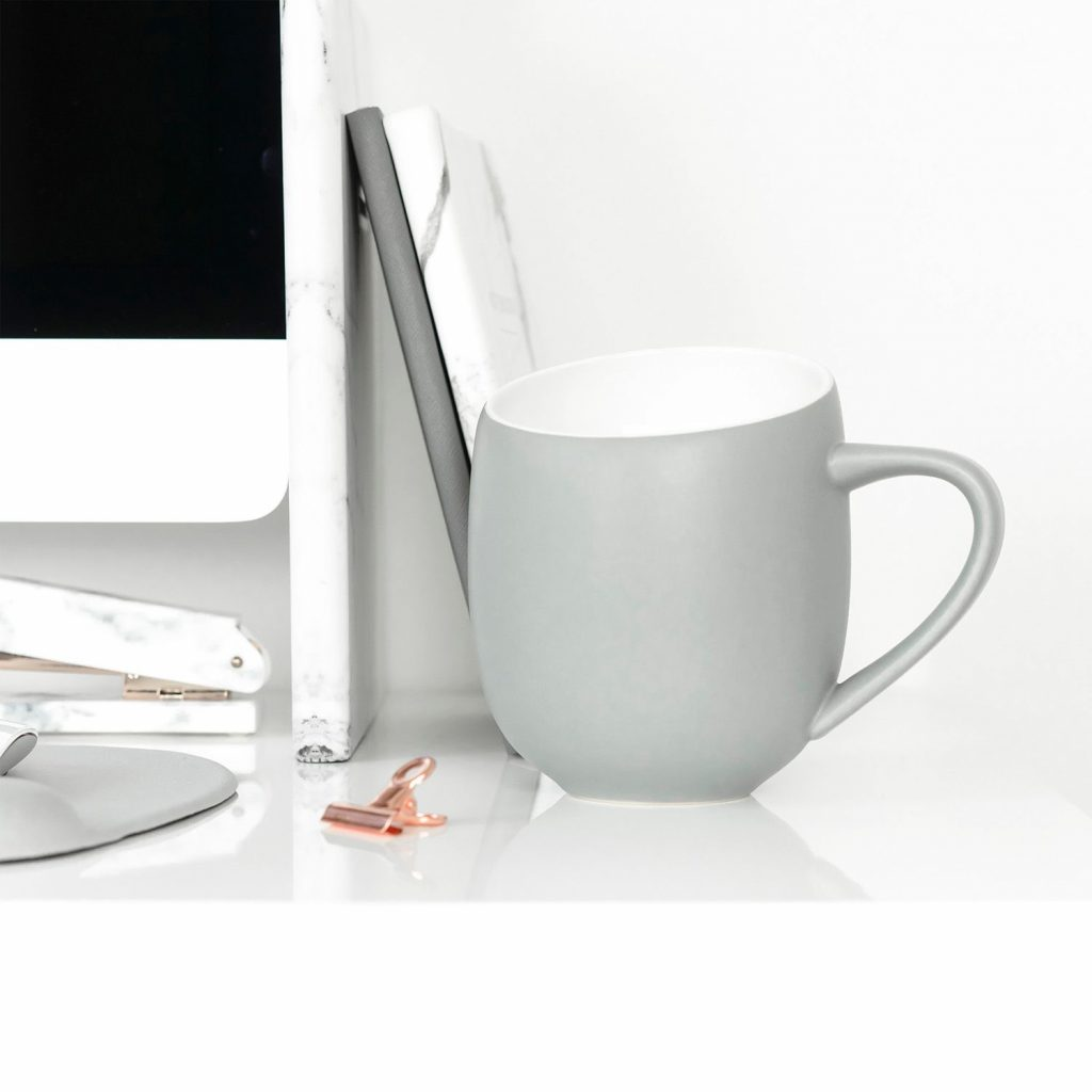 Gray cup on desk