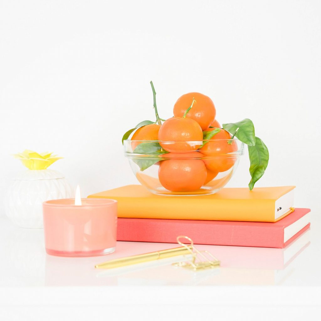 home decor items bowl of fruit and books