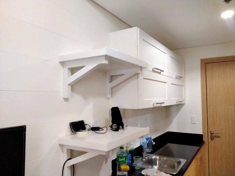 white shelves and cabinets